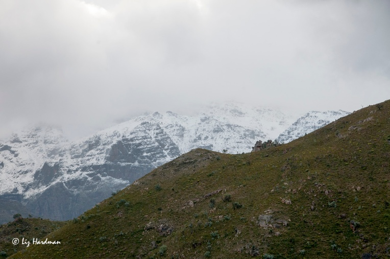 The rugged mountains of the Du Toitskloof are wreathed in swirling clouds and snowy drifts.