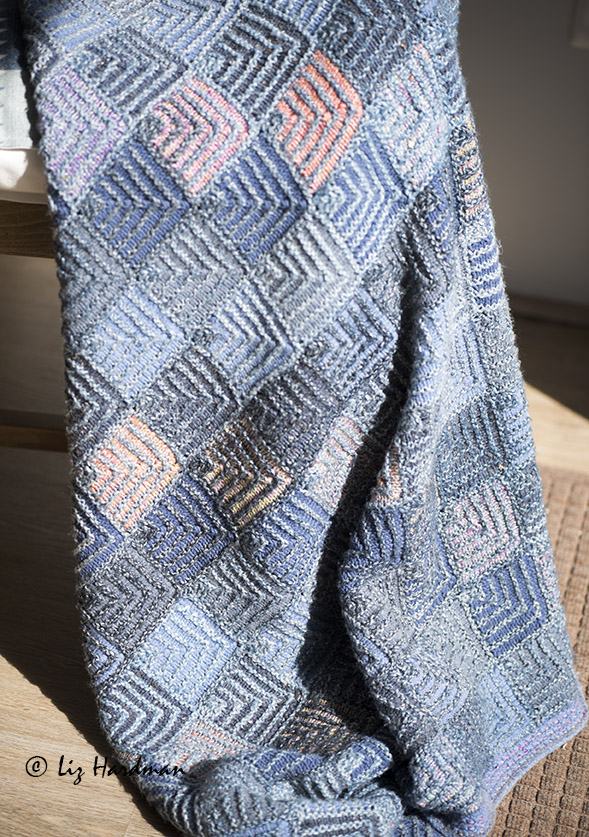 One of my mitred square blankets using odd ends of yarn.
