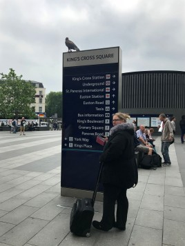 Pluto, perched outside the King's Cross station