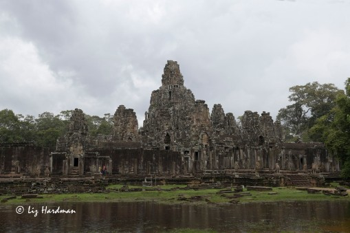 The Bayon appears erratically structured, but close-up the grandeur of it's 54 towers and 216 eerie stone sculptures evokes awe.