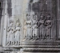 The sensual apsaras (dancers) each one different from the next. Holding alluring poses, they are shown wearing ornate jewelry and exquisite headgear.