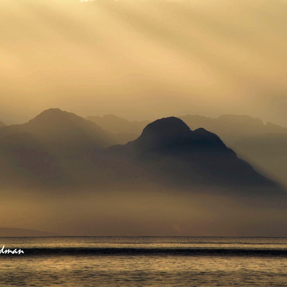 Golden sunrise over False Bay and Mountains